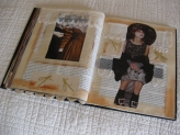 Altered book pages using lace, dictionary pages, collage, paint and handmade paper