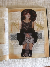 Altered book page using collage, paint, lace, handmade paper, and tape